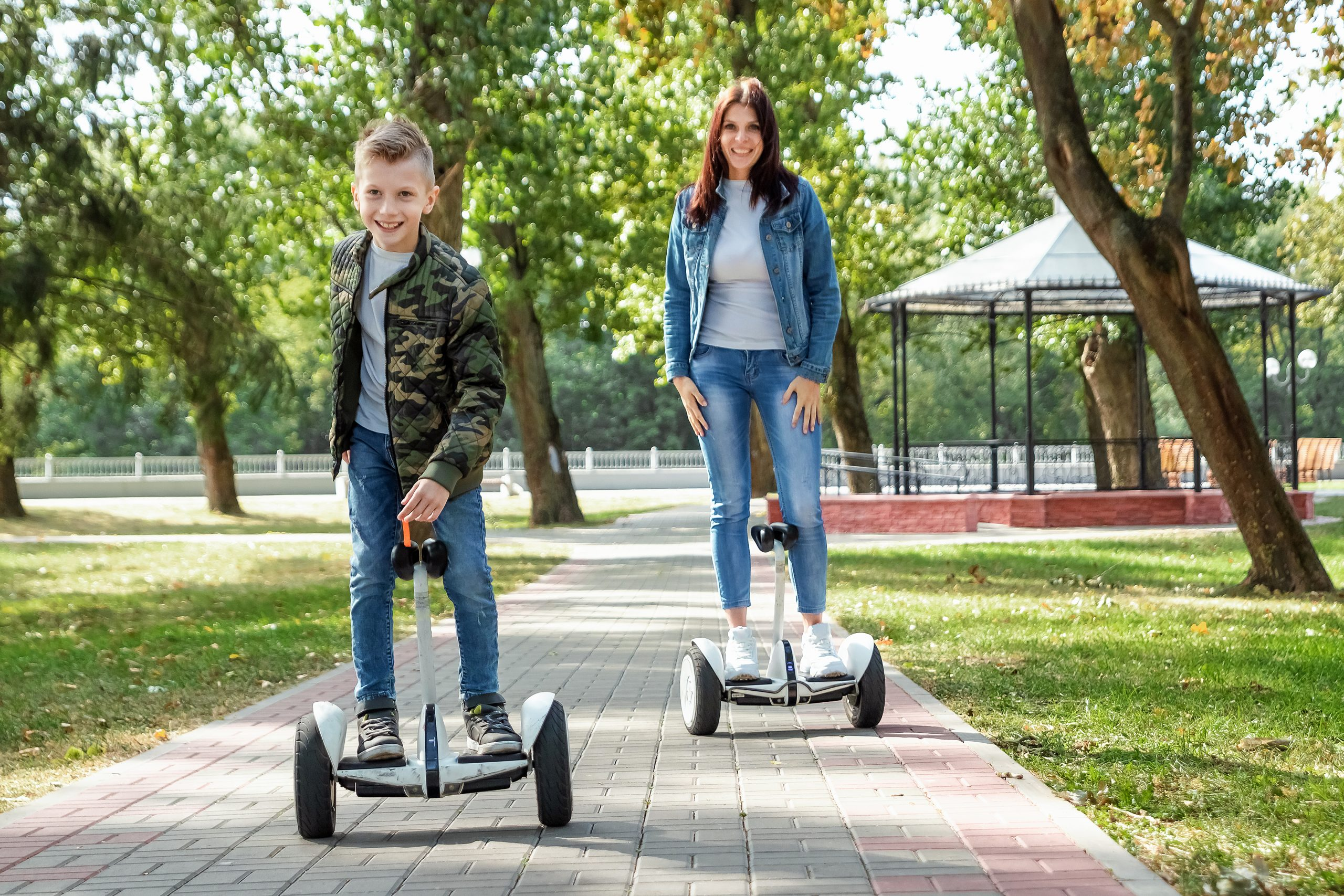 Mom and son ride a hoverboard